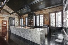 """Photos courtesy Rachel Perkoff Lenny Kravitz's former French Quarter pad, a 200-plus-year-old Creole cottage whose interior is the decor equivalent of snakeskin pants (Kravitz coined the term """"bordello modern"""" to..."""