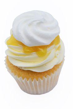 Just like our lemon meringue cake, just a bit smaller. Lemon sponge with lemon rind, a lemon curd centre, lemon buttercream topped with more lemon curd and meringue piece. Lemon Meringue Cake, Lemon Buttercream, Lemon Curd, Mini Meringues, Lemon Sponge, Cupcake Flavors, Cake Makers, Cupcakes, Tasty