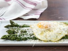 Asparagus alla Milanese has just three main ingredients—asparagus, a fried egg, and grated Parmigiano-Reggiano cheese—but don't let that simplicity fool you. It's an elegant and near-perfect dish: the asparagus is poached until juicy, the egg is lacy around the edges and has a flowing yolk that mingles with the cheese to make a flavorful sauce.