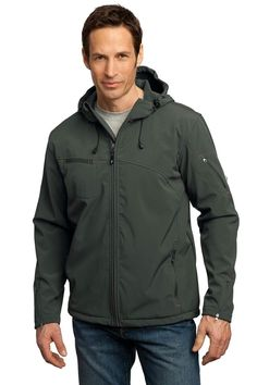 Port Authority Textured Hooded Soft Shell Jacket. J706 96/4 poly/spandex woven shell bonded to 100% polyester microfleece with laminated film insert to repel water and wind 1000MM waterproof rating 1000G/M2 breathability rating Hood with drawcord and toggles for adjustability Storm flap with chin guard Ergonomic zipper pulls Zippered chest and sleeve pockets with contrast bar tack Front zippered pockets with contrast bar tack Port Pocket? for easy embroidery access Open hem with drawcord and… Men's Coats And Jackets, Jackets Online, Mens Sweatshirts, Hoods, Hooded Jacket, Windbreaker, Mens Fashion, Sleeves, Clothes
