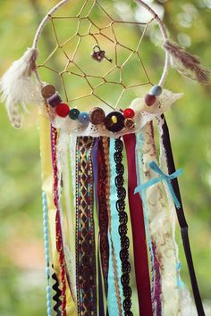 For a more personal touch, add some of your stuff in your dream catcher like your pendant, some buttons you had over the years, rosary beads and some cloth and laces from dresses and clothes you've had.