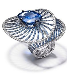 Harmony Ring by Adler Jewelers  25ct cushion-cut sapphire, surrounded by sapphires and diamonds