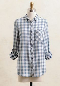 Add a rustic touch to any classic look with this cozy button-up that features an allover checkered print in faded navy and white. Complete with a pointed collar and single pocket at the front, it...
