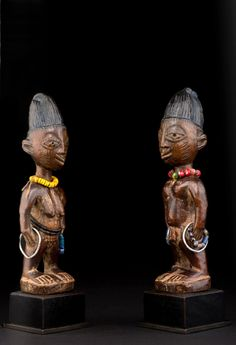 Africa | 'Ibeji' figures from Nigeria | Wood, glass beads, metal, pigment  ||| Source ~ http://issuu.com/tribalartsociety/docs/catalogue_jan_2014_f3670b6ad35ccf