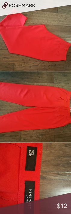EUC..Nine west crepe pants Brilliant red pants with a crepe texture. I am 5'9 so these fit me more like ankle cut than full length trousers. Worn only once or twice, does also have a pleated waist. Thanks for looking! Nine West Pants