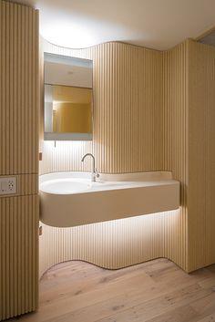 hotel bathroom The Public Hotel New York by Herzog amp; de Meuron The bathroom features custom cabinets and a sink wall of curvilinear white oak fluting. Bathroom Layout, Bathroom Colors, Bathroom Interior Design, Modern Bathroom, Bathroom Grey, Interior Ideas, Bathroom Ideas, Wc Public, Public Hotel