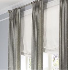 Layer darker gray trellis curtains against light grey walls for a gorgeous subtle contrast. Love how the sweeping of our relaxed roman shade softens the look.
