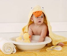 Hooded towels and washcloths are essential gear for baby bath time.