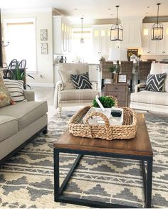Beautiful Farmhouse Living Room And Kitchen Area. Love The Pendant Lights,  Coffee Tab And The Rug.
