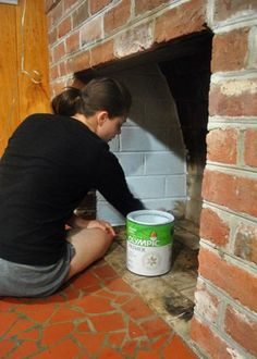 How to Paint Brick Fireplace Happenings | Young House Love-- paint the inside of the fireplace a soft white.