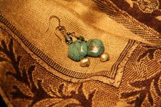 Turquoise & Green-Gold Pearl Earings ~  I haven't made jewelry in years, and then only ever made a few pieces. So when I decided to make these I wasn't too sure how to go about it; I had to dig out my books on jewelry making!  I made these turquoise and green-gold fresh water pearl earings as a birthday present for a girlfriend (she loved them by the way). I used a woven silk pashmina to display them. ~ Epi