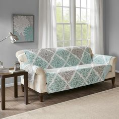 Claire Printed Sofa Protector - Madison Park a fresh touch of color and print to your decor with our Madison Park Claire sofa protector. Our reversible sofa protector features a printed diamond motif in aqua and grey hues for a bold touch, or Armchair Slipcover, Loveseat Slipcovers, Cushions On Sofa, Aqua Blue, Blue Grey, Aqua Quilt, Printed Sofa, Sofa Protector, Box Cushion
