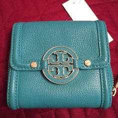 Tory Burch Amanda wallet,  Turquoise Leather NWT This classic Amanda French wallet is in a pretty turquoise color. Inside has eight slots for credit cards and bills. The outside has a large zipper coin compartment and all hardware is in gold. Beautiful! New, never used, with tag. Tory Burch Bags Wallets