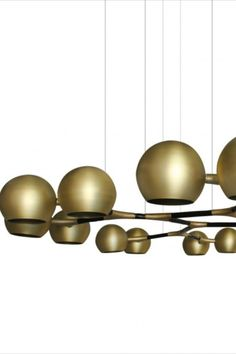 Just like the God of the sky and the rising sun, HORUS Suspension Light promises to be a reference in modern interior design. Featuring a structure in matte black lacquered brass and shades in matte brass, this chandelier is perfect for creating a grand reveal over a fierce living room sofa.