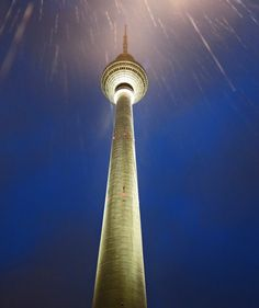 Fernsehturm TV tower in the rain at night - Berlin (via David J Rodger)