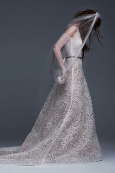Light ivory strapless A-line macramé lace gown with French tulle build up and sleeves.