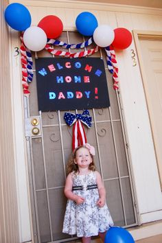 Welcome home sign. Look at that sweet little face. Welcoming Home American's Heroes.