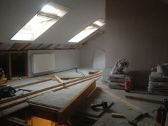 Two velux windows being installed in a home in Edinburgh