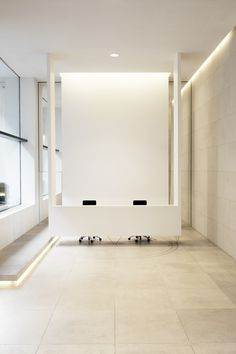 Entrance area by Belgian Architect Jacques Van Haren. Hanging reception desk.