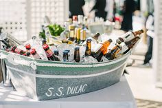 Beverages in Boat-Shaped Cooler | Photo: Briana Moore Photography.