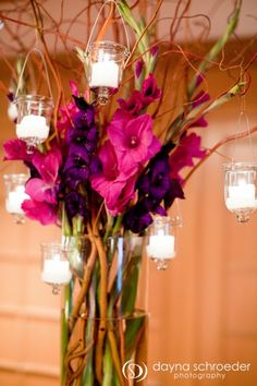 Pretty tall centerpiece idea - gladiolus, curly willow, candles