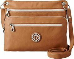 For the woman who does not settle for anything less-this crossbody is the epitome of style and utility. The slick design and leather finish will lure you into thinking it s an uptown fashion piece. But the large zipped pockets and adjustable strap held by hooped silverware also reveal a convenient side for taking it everywhere you go.