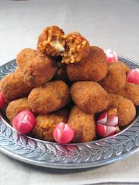 These croquettes are called supplì al telefono in Italian; 'telephone style' because when you split them open while they're hot, the melted mozzarella centre forms a string between the two halves like an old fashioned telephone!
