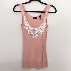 New York & Co Sparkly Sequin Pink Tank This pink sequin shirt is soooo cuteeee, but I don't have anywhere to wear it to! It's a size Small and is on the longer side (like cover half your butt - so wear tight pants). Only worn a few times - gently used condition  New York & Company Tops Tank Tops