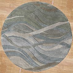 @Overstock - This round 'Metro Classsic' area rug from Horizon is handmade from 100-percent New Zealand wool. Shades of grey, green, and rust dance about this lush hand-carved rug in broad, waving strokes for  contemporary style.  http://www.overstock.com/Home-Garden/Alliyah-Handmade-New-Zeeland-Blend-Classic-Grey-Green-Wool-Rug-6Round/6417276/product.html?CID=214117 $174.99