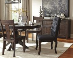 """Ashley Furniture, """"Trudell"""" Dining Set; Crafted of 100% quality pine wood for years of satisfaction, the Trudell dining room extension table truly is a statement piece. Its distinctive finish with dramatic golden-brown contrasting and subtle wire brush distressing takes the Trudell dining room table from simple to simply extraordinary. Dining Room Sets, Dining Room Furniture, Dining Room Table, Bed Furniture, Dining Chairs, Dining Bench, Ashley Home, Sideboard Buffet, Cabinet Doors"""