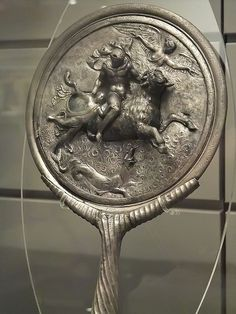 Silver Mirror from the tomb of a Roman woman that was once gilded and covered with an amalgam of Mercury 2nd century CE Vallerano