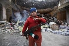 Ahmed, an 8-year-old boy from Aleppo, Syria fighting in Syria's civil war - Mar 2013, Photo Sebastiano Tomada