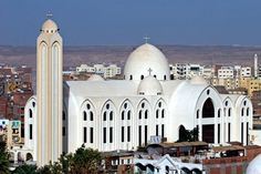 Coptic Church Aswan, Egypt~name for the largest Christian church in Egypt and the Middle East. The Church belongs to the Oriental Orthodox family of churches, Valley Of The Kings, Church Architecture, Episcopal Church, Egypt Today, Christian Church, Chapelle, Place Of Worship, Roman Catholic, Around The Worlds