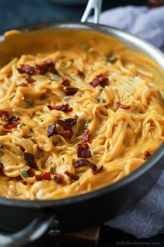 Creamy Butternut Squash Alfredo Pasta permeated with fresh sage and thyme then perfected with a garnish of salty bacon on top! The fall recipe is silky smooth, luscious, healthy and absolutely addicting. | joyfulhealthyeats.com #glutenfree #fall