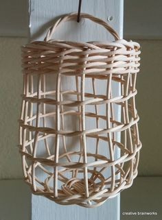 8/7/16 - BROWN GARLIC BASKETS ARE TEMPORARILY OUT OF STOCK Garlic baskets are approximately 5-6 high and 4-5 across, with a 3.5-4 opening. Variations are due to handcrafting. Garlic is easily dropped in and retrieved. Hang on a cuphook under your cupboard near your cutting board.