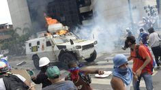 cool Armored vehicle plows into crowd in Venezuela