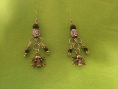 Skull and crossbone earrings with swarvoski crystal by tonnibrill, $25.00