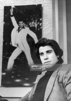 Actor John Travolta sits beside a promotional poster of himself from director John Badham's film, 'Saturday Night Fever' during a television interview. Get premium, high resolution news photos at Getty Images 70s Hair, Saturday Night Fever, Actor John, Olivia Newton John, Hooray For Hollywood, John Travolta, Iconic Movies, Celebs, Celebrities