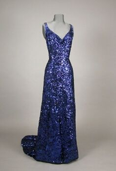Sapphire Blue Sequined Evening Gown   Attributed to Worth, French, 1930s   With low V front and back, blue stone straps, square train, mousseline embroidered with shamrock-shaped sequins, size 8.