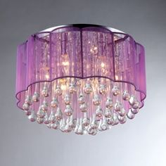 Introduce a touch of contemporary glamour into your bedroom with this head-turning ceiling lamp from Erida. Cascades of teardrop-shaped crystals rain down from the center of the fixture, reflecting th