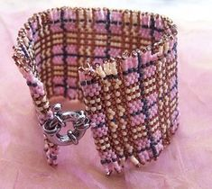Can't find on site but this looks really cool and would be pretty easy to work up with graph paper.  Cuff by Framboise.