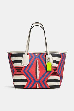 For summer days and weekends: a colorful printed Coach Taxi Tote.