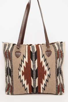 "Newly Designed Handwoven of imported 100% wool in classic Zapotec styles and rich colors. These handcrafted handbags are a Southwest style favorite. Zipper closure, fully lined inside, interior pocket. Apx. 15"" x 18"""