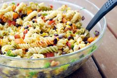 We love this pasta salad so much it becomes a main dish every time we make it. We take whatever steak or chicken we have leftover from grilling one night, slice it up and throw it in this salad. It's such a satisfying lunch or dinner -- bursting with flavor -- and soooooo good cold (right out of the fridge). It seems a little crazy to mix all these fiery Mexican flavors with Italian dressing, but trust me, it works. I'm not big on drenching pasta salad in dressing; I like just enough to give…