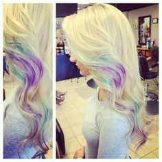 Love the placement of these purple and teal streaks in this long blonde hair! More Hair Styles Like This!