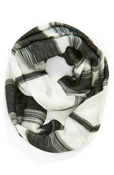 This soft, textured infinity scarf will add a dash of casual sophistication to any outfit.