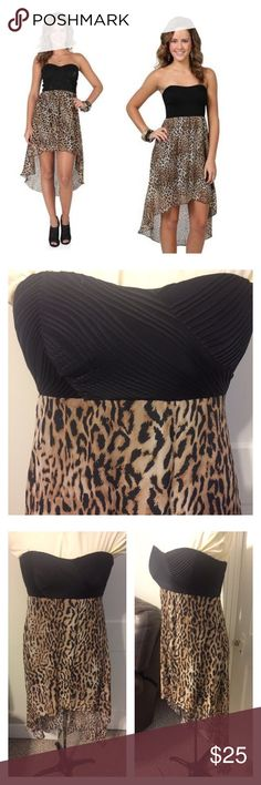 Almost Famous cheetah print dress Be beautiful in this fabulous high low strapless dress. Worn a couple times. In great shape. No rips or stains. Nice elastic back helps keep it snug around the back. Rubber lines to keep from falling down. Easy to dance in without fear. Measures 11in under bust. Armpit to front hem 25 in. 40in long in back Almost Famous Dresses High Low