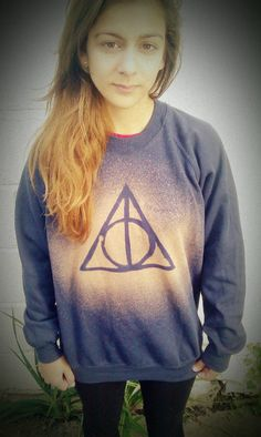 Using a bleach spray technique, make your own Deathly Hallows sweatshirt, tshirt, or whatever you want. | 27 Harry Potter DIYs That Are Basically Magic