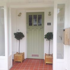 A front door painted in a Dulux colour match to Farrow and Ball Lichen. Outside House Colors, Painted Doors, House Front, House Restoration, Exterior Front Doors, Front Door, Exterior Doors, Porch Tile, Front Door Farrow And Ball