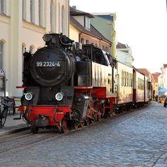 "Mit dem Molli durch enge Gassen in Bad Doberan / steam train called ""Molli"" in Bad Doberan, Germany, Europe"